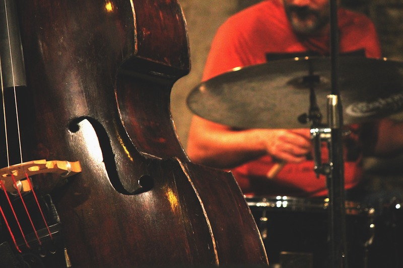 Bass player and drummer playing jazz at coffee shop