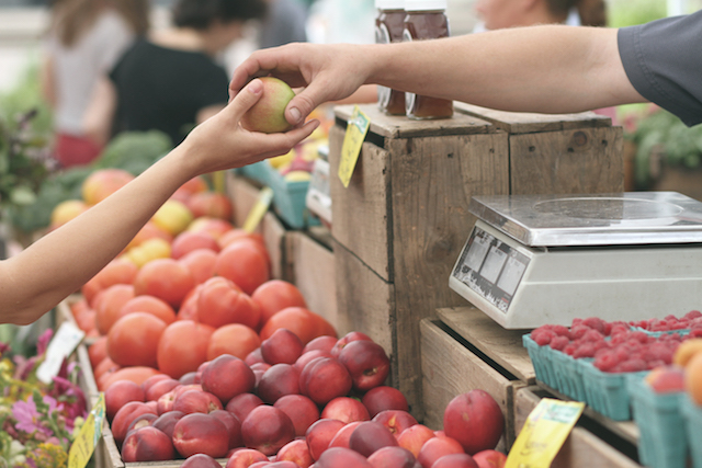 Customer purchases extra fruit due to sale promoted via promotional audio message.